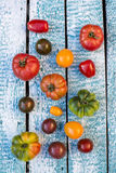 Heirloom tomatoes on blue wood Royalty Free Stock Image