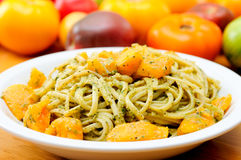 Heirloom tomatoes pesto sauce Stock Images