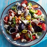 Heirloom tomatoes salad with cheese and basil Stock Image