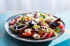 Heirloom tomatoes salad with cheese and basil Royalty Free Stock Photos