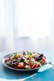 Heirloom tomatoes salad with cheese and basil Stock Photography