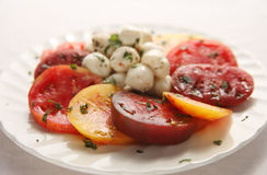 Heirloom tomatoes and small mozzarella balls Stock Image