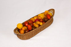 Heirloom Tomatoes. In a weaved basket royalty free stock photography