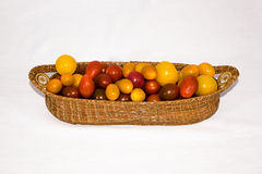 Heirloom Tomatoes. In a weaved basket stock image