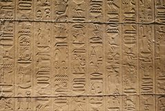 Heiroglyphs. Close up of heiroglyphs on sandstone Stock Photos