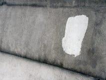 Heise alte Wand des grauen Gipses mit Weiß malte Teil 2 Lizenzfreies Stockfoto