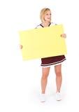 Hejaklacksledare: Den gulliga unga kvinnan rymmer upp det tomma tecknet Arkivbild