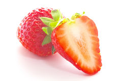 Hel jordgubbe och skivad jordgubbe Arkivfoto