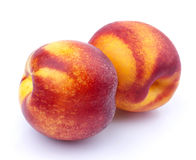 Hel nektarinfrukt som isoleras på vit bakgrund royaltyfri foto