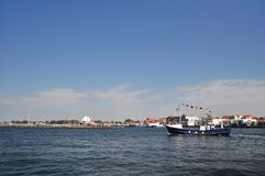 Hel port. HEL, POLAND - AUGUST 2017: Boat in the Hel port turning around, clear sky Stock Image
