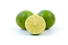 hela half limefrukter Fotografering för Bildbyråer