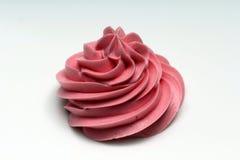 Helado rosado en el fondo blanco Foto de archivo libre de regalías