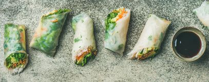 Vegan spring rice paper rolls with chopsticks, wide composition. Helathy Asian cuisine. Flat-lay of vegan spring rice paper rolls with vegetables, soy sauce Royalty Free Stock Photos