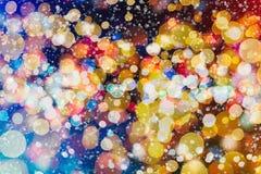 Helder abstract cirkelbokehonduidelijk beeld als achtergrond op een donkere achtergrond Stock Fotografie