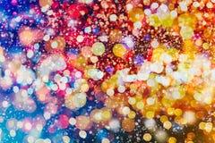 Helder abstract cirkelbokehonduidelijk beeld als achtergrond op een donkere achtergrond Stock Foto's