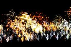 Helder abstract patroon in een kleuren verschillende lijnen en vlekken op een zwarte Stock Foto's