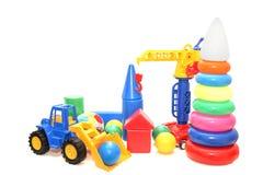 Helder gekleurd speelgoed op een witte geïsoleerde achtergrond stock fotografie