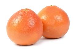 Heldere die grapefruit op witte achtergrond wordt geïsoleerd Stock Foto
