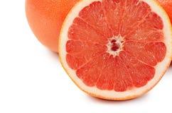 Heldere die grapefruit op witte achtergrond wordt geïsoleerd Stock Afbeelding