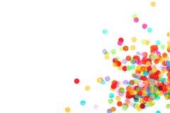 Heldere die multicolored confettien op witte achtergrond worden ge?soleerd royalty-vrije stock foto
