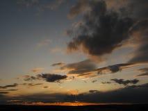 Heldere en donkere wolken Stock Fotografie