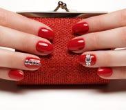 Heldere feestelijke rode manicure royalty-vrije stock foto's