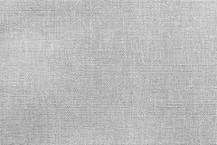 Heldere grijs-witte textuur van stof of textielproduct Stock Foto's