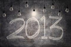 Heldere ideeën in 2013 met gloeilampen Stock Afbeeldingen