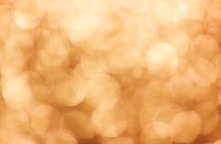 Heldere oranje achtergrond met grote bokehlichten stock afbeeldingen
