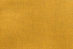 Heldere oranje textuur van stof of textielproduct Stock Fotografie