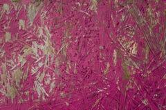 Heldere roze houtvezelplaat met geslagen verf Ruwe Oppervlaktetextuur royalty-vrije stock afbeelding