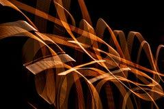 Heldere spiraalvormige patronen van lichte stroken op een zwarte achtergrond royalty-vrije stock foto