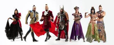 Heldere sprookjekarakters in kostuums voor witte achtergrond royalty-vrije stock afbeeldingen
