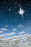 Heldere ster in blauwe hemel Stock Foto's