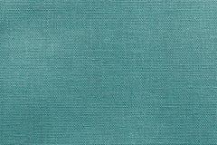 Heldergroene blauwe textuur van stof of textielproduct Stock Foto's