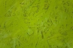 Heldergroene houtvezelplaat met witte vlekken van verf Ruwe Oppervlaktetextuur royalty-vrije stock fotografie