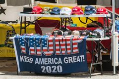 Donald Trump Merchandise On Sale At Georgia Outdoor Popup Market. Helen, GA, USA - June 2, 2018:  An assortment of Donald Trump and conservative merchandise sits royalty free stock image