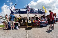 Couples Shop For Merchandise At Popup Trump Shop In Georgia. Helen, GA, USA - June 2, 2018:  Couples shop for merchandise at the Trump Shop, a popup outdoor stock photo