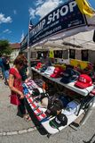 Woman Shops For Merchandise At Outdoor Donald Trump Popup Store. Helen, GA, USA - June 2, 2018:  A woman looks over the merchandise at the Trump Shop, a popup royalty free stock photography