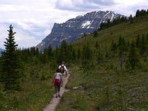 Helen Lake Trail. Hikers on Helen Lake Trail, Banff National Park, Alberta, Canada Stock Photo