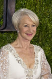 Helen Mirren Arrives at the 2015 Tony Awards. British actress Helen Mirren is resplendent in a lacey ivory-colored gown by Badgley Mischka and Fred Leighton Royalty Free Stock Photo