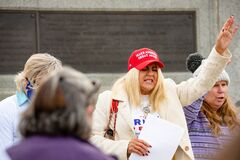 Free Helena, Montana - Nov 7, 2020: Woman Wearing Red Make America Great Again Hat Praying At Stop The Steal Rally In Support Of Donald Stock Image - 205382311