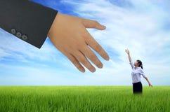 Helfende Hand für Geschäft Stockfoto