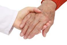 Helfender Älterer des Erwachsenen im Krankenhaus Stockbilder