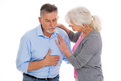 Helfender Mann der Frau mit Schmerz in der Brust lizenzfreie stockfotos