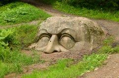 Helft-hoofd van steen stock fotografie