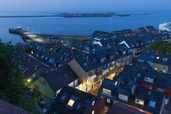 Aerial night view village Helgoland with lluminated main street Royalty Free Stock Photography