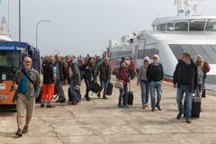 People just disembarked the ferry at island Helgoland Royalty Free Stock Photo