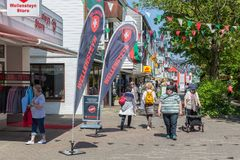 Day trippers in main street Helgoland to do tax-free shopping. HELGOLAND, GERMANY - MAY 22, 2017: Shopping people in main street of Helgoland with many Royalty Free Stock Images