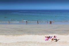 Helgon Malo Beach With People Sunbathing Royaltyfria Bilder